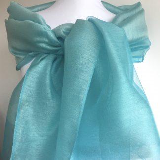 étole turquoise avec perles